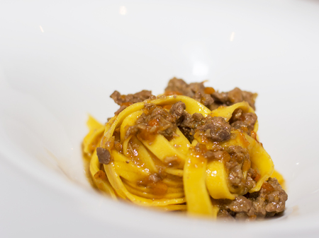 Noodles with white ragout of duck and saffron