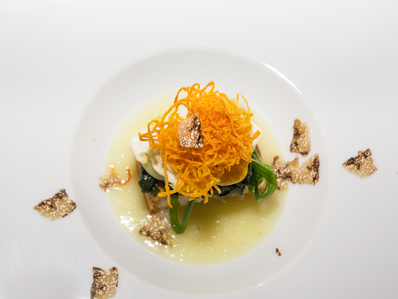 Bread cooked on fine cream of potatoes, quail egg and truffle