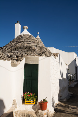 Typical Trullo  of Alberobello with blue sky background Editorial
