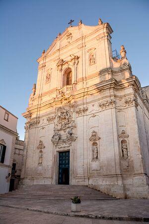 Facade of the Basilica of San Martino in Martina Franca at sunset (Italy) Editorial