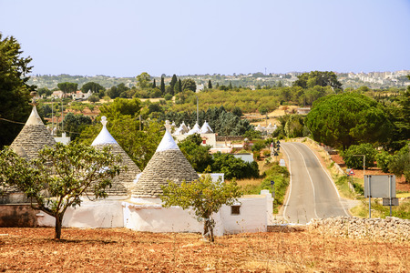 Trulli in the countryside of the Itria valley Фото со стока