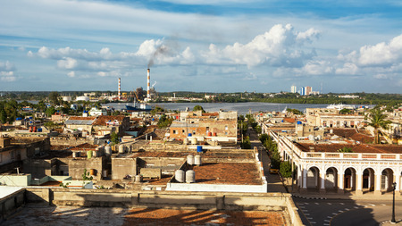 Top view of the roofs of Ciefuegos and its port with the chimneys of the few industries
