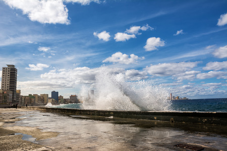 Promenade of the Malecon of Havana with crashing waves