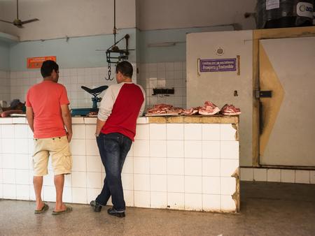 Havana, Cuba - 11 december 2017: Cuban customers in a typical butchery in Old Havana Editorial