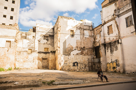 Havana, Cuba - December 3, 2017: Guarded parking between Havanas decadent palaces Editorial