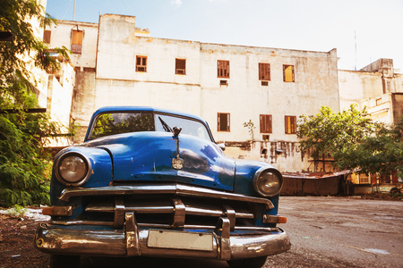 old blue american car parked in old havana