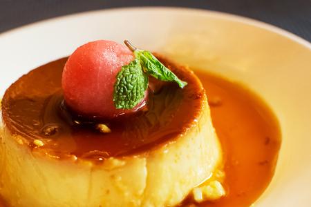 Flan de leche with watermelon ball Stock Photo