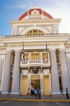 Cienfuegos, Cuba - December 7, 2017: Cienfuegos Municipal Palace and cuban people Stock Photo - 111644069