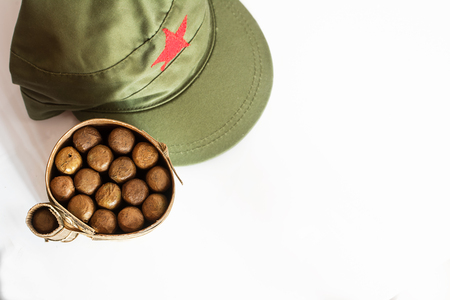 Some Cuban cigars rolled in banana leaf and military cap