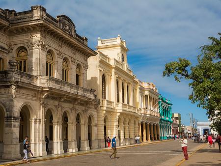 Santa Clara, Cuba - December 10, 2017: Palaces in the center of Santa Clara on a Sunday morning with the Cubans walking