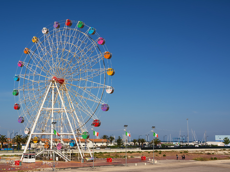 Pescara, Italy - May 20, 2018: Ferris wheel at the port of Pescara with blue sky Editorial