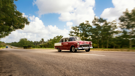 Old american classical car in highway road of Cuba Editorial