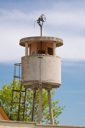 Reinforced concrete guard tower in a former military barracks