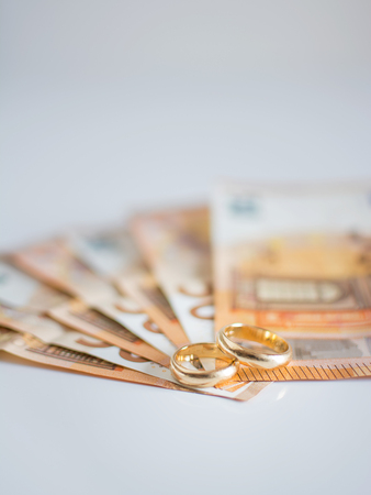 Wedding rings and banknotes