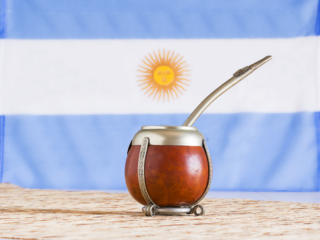 mate, mate grass (yerba mate) with flag of Argentina in the background