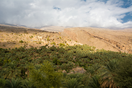Village of Misfat al Abriyyin with its oasis of date palms (Oman) Imagens