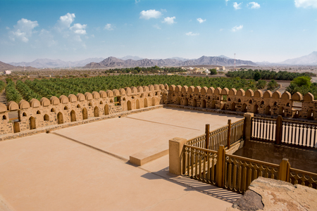 Terrace of the fort of Jabrin and in the background of Bahla and date crops (Oman) Editorial