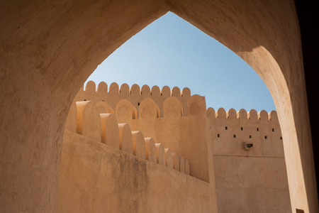 Arch and scalloped walls of the Fort of Nahkal (Oman)
