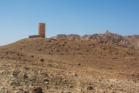 Ancient tower on top of a rocky hill in Oman Editorial