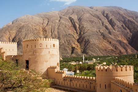 Nakhal Fort and oasis of date palms under the mountain (Oman)