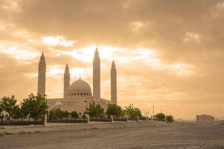 The four minarets and the dome of the new Mosque of Nizwa (Oman)