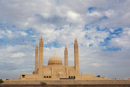 The four minarets and the dome of the new Mosque of Nizwa (Oman) Reklamní fotografie - 123114548