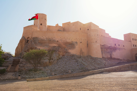 Ancient Fort of Nakhal with flag (Oman) Editorial