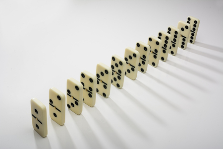 domino tiles in a row on a white background