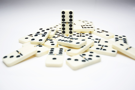 Concept of the leader with domino tiles falling in stack and one standing