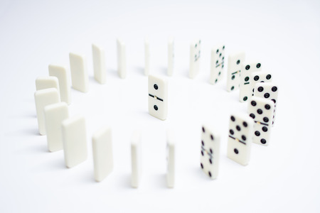 Leadership concept with domino tiles in circle