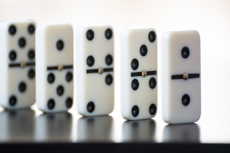 domino tiles in a row on a black background