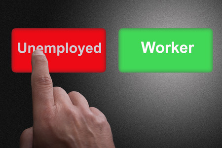 Two Buttons with written Unemployed and Worker and pointing finger, on a gray gradient background Stock Photo
