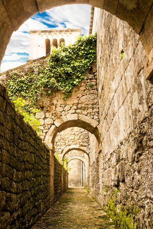 View below the lateral buttresses of the ancient Abbey of San Liberatore a Majella in Abruzzo (Italy)