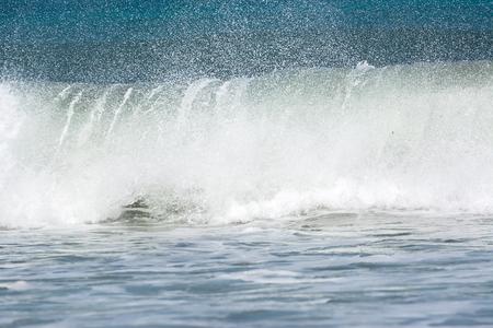 A foaming wave that breaks
