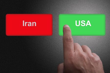 Buttons with written USA and Iran and pointing finger, on a gray gradient background: Concept of choosing USA