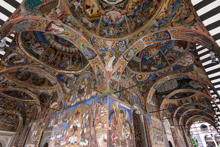 Religious frescoes on the treatises from the Bible, painted on the church wall in Rila Monastery, Bulgaria Editorial