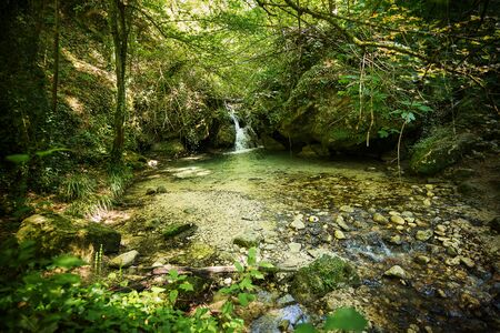 Valley of the Alento river in Serramonacesca (Italy): small lake and waterfall in a wild environment