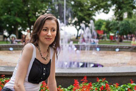 Tourist takes a souvenir photo in front of the Burgas fountain, Bulgaria
