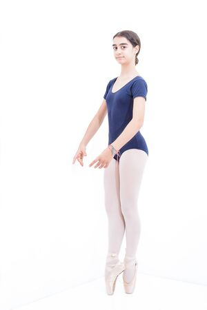 A ballet dancer on tiptoe