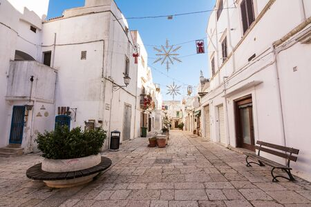 Street in the historic center of Cisternino in Puglia (Italy)