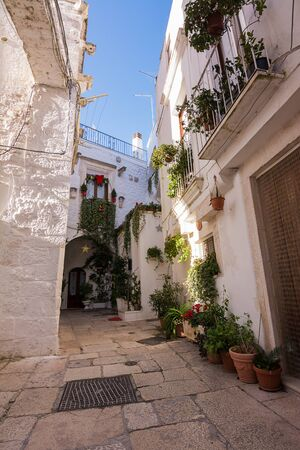 Typical alley in the historic center of Cisternino in Puglia (Italy)