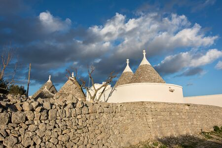 typical houses in the Apulian countryside and a sky with clouds Фото со стока