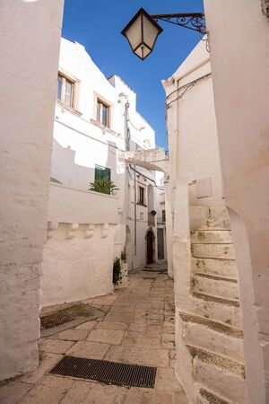 Characteristic alley in the historic center of Cisternino, typical of several Apulian villages Фото со стока