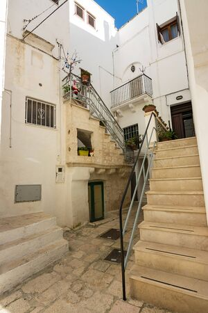 Characteristic alley and stairs in the historic center of Cisternino (Italty) Фото со стока