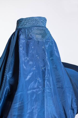 Blue burqa on white background, traditional women's clothing from Afghanistan and Pakistan 免版税图像 - 140270569