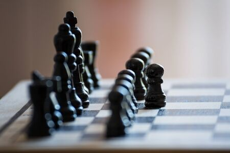Chess pieces on the chess board with selective focus and crop fragment. Business and motivation concept. Copy space