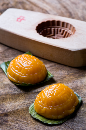 traditional ang ku steamed glutinous dessert with red bean paste filling together with the wooden mould