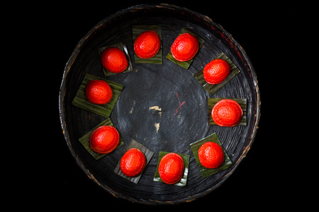 turtle bean: steamed red tortoise steamed glutinous cake ang ku arranged in traditional bamboo rattan basket