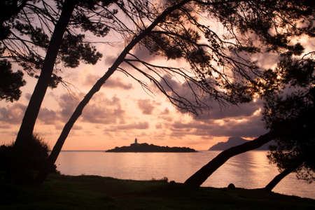 Sunrise in the lighthouse of aucanada photo