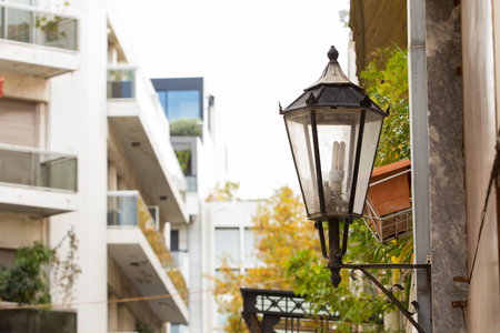 A street lamp hanging from a wall in one of the neighborhoods of Athens, Greece Stock Photo